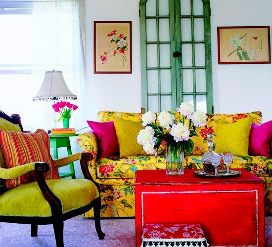 Image from One Kings Lane. Yellow pairs perfectly with pink and orange as seen in this living room.