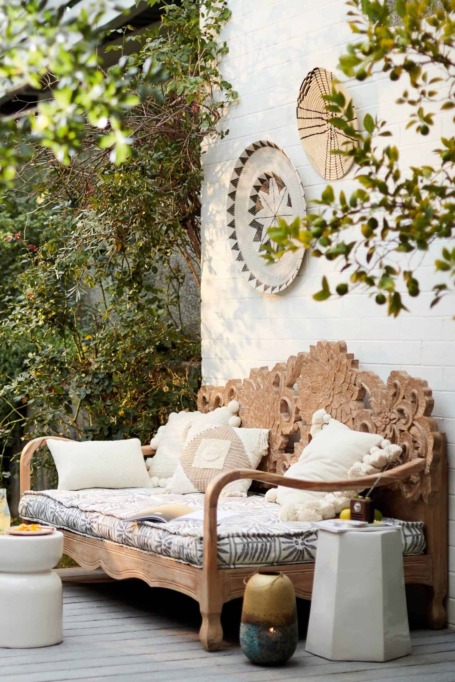 Daybed in a sunny spot loaded with cushions and a few handy side tables for drinks & nibbles.